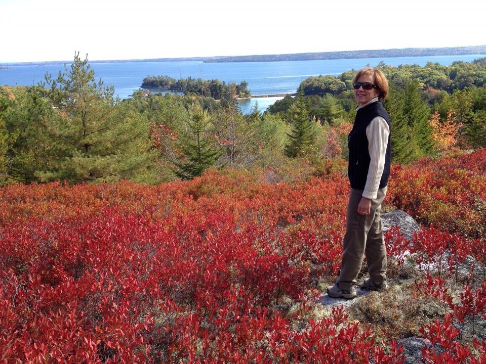 Cynthia Murphy by the Maine coastline