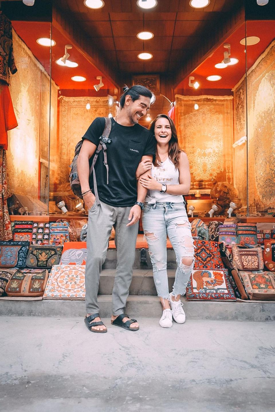 attractive couple, woman and man entrepreneurs laughing at gift shop in nepal