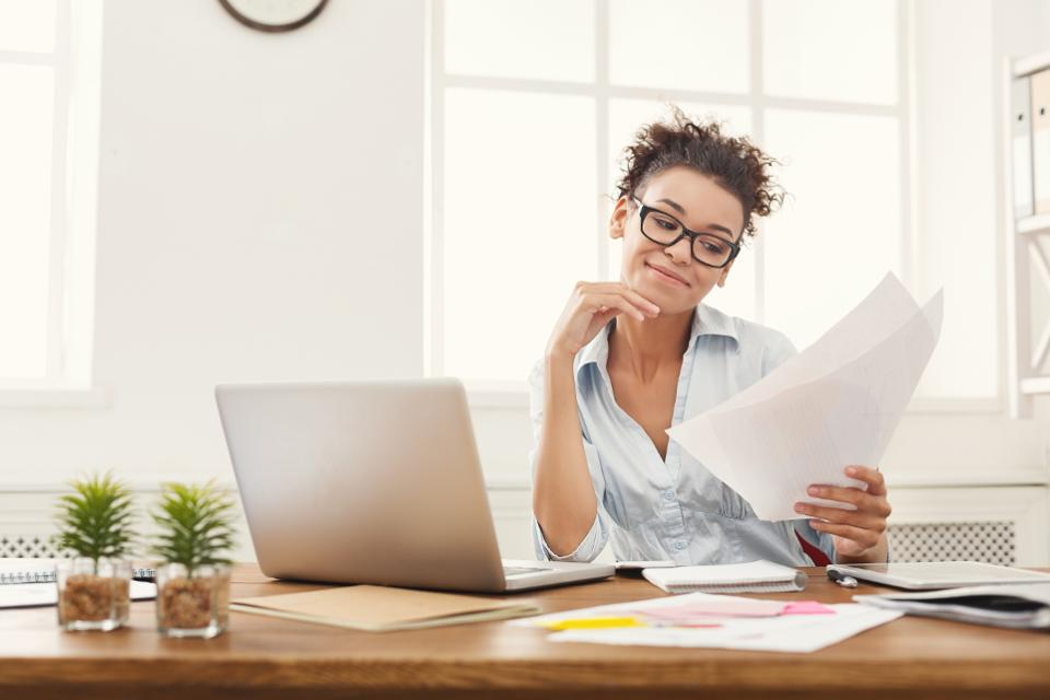 Woman reading documents searching for job.