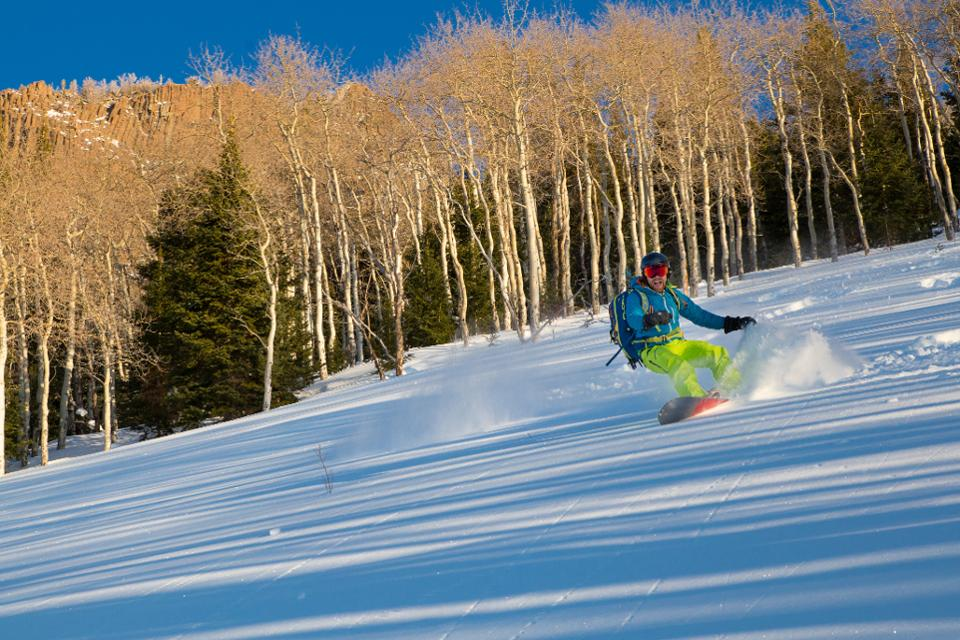 A snowboarder on a beginner slope at Bluebird Backcountry